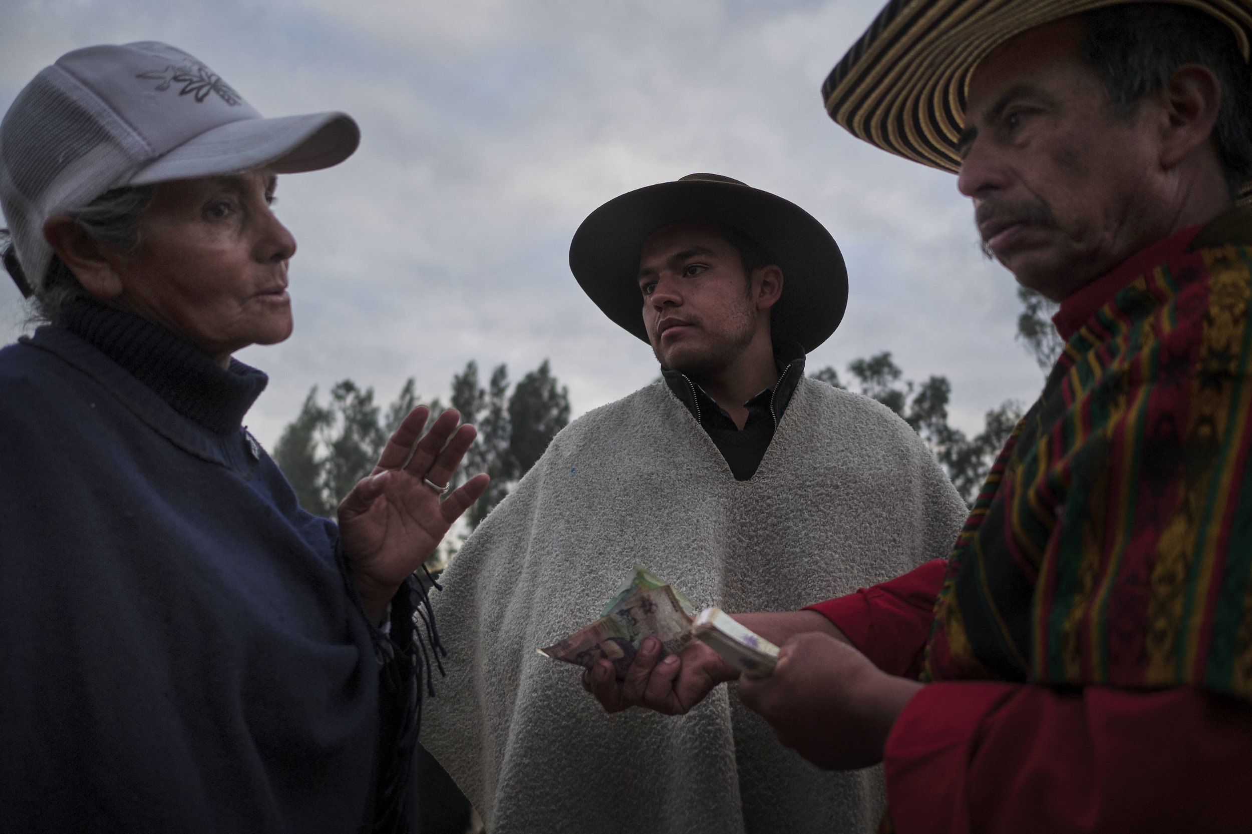 Bargaining at the animal market in Sogamoso, Boyaca, Colombia