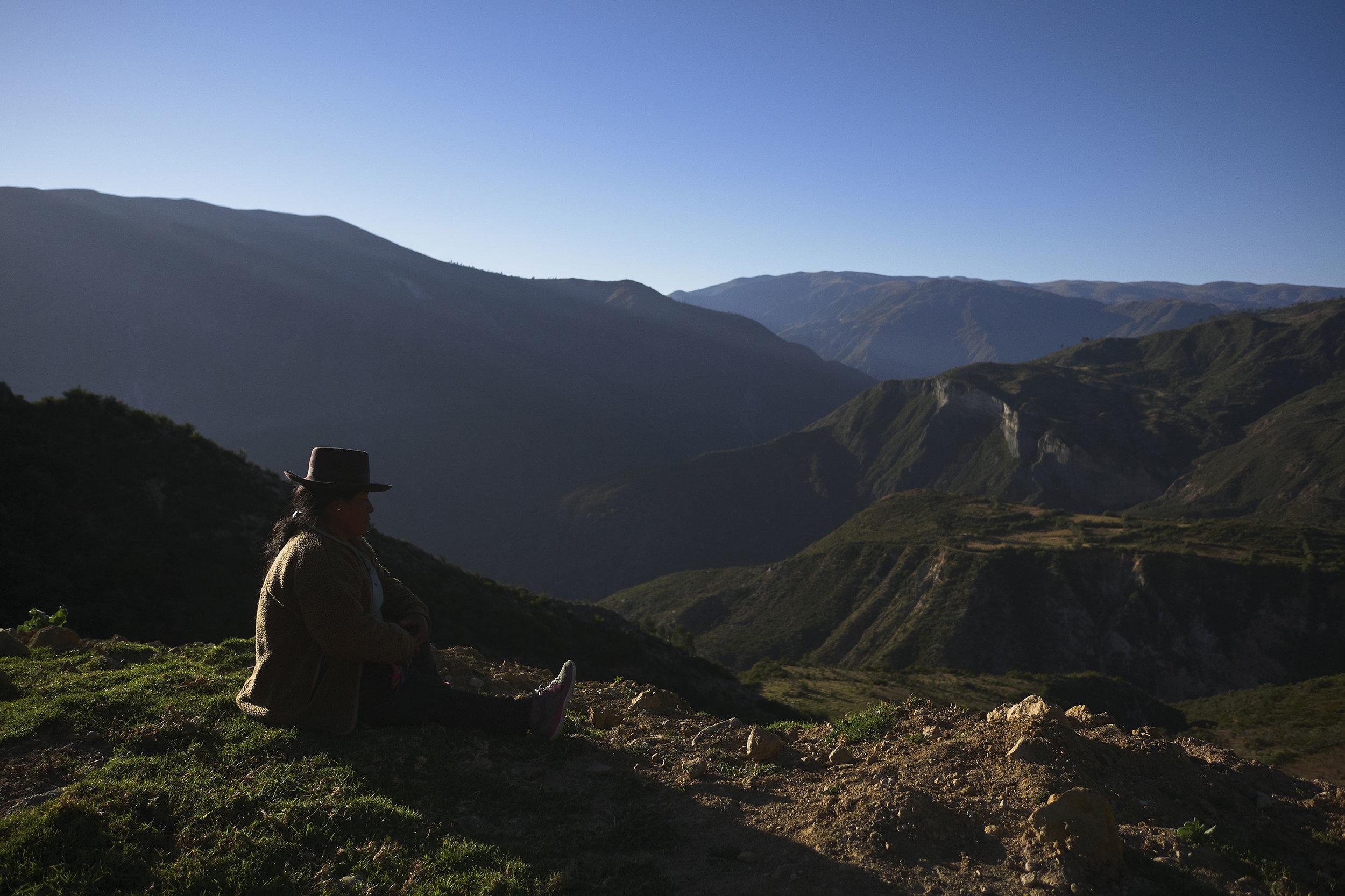 Rural woman with a mountain backdrop Ayacucho region, Peru