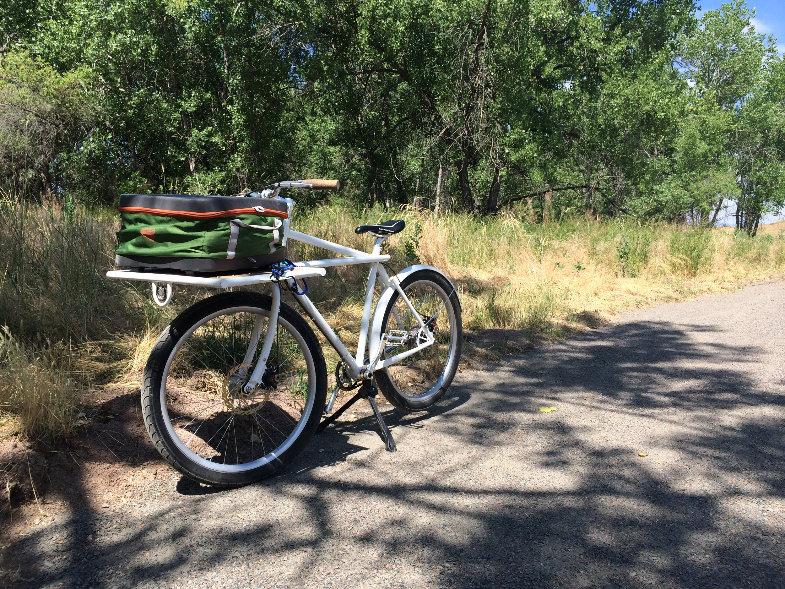 This was a bike we built while we were in the Bay area. With a postal bike frame, and enough space on the front for several bags of groceries it makes a great utility bike. A front dynamo hub runs the headlight, and an internal hub gets the gearing right.