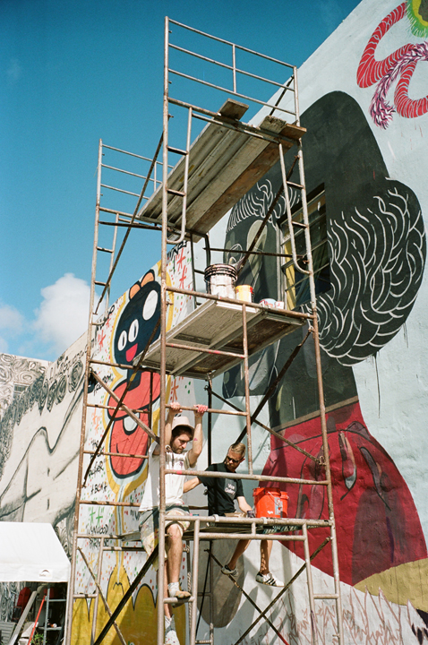 BASIK on the right with GOLA climbing the scaffold in Wynwood.