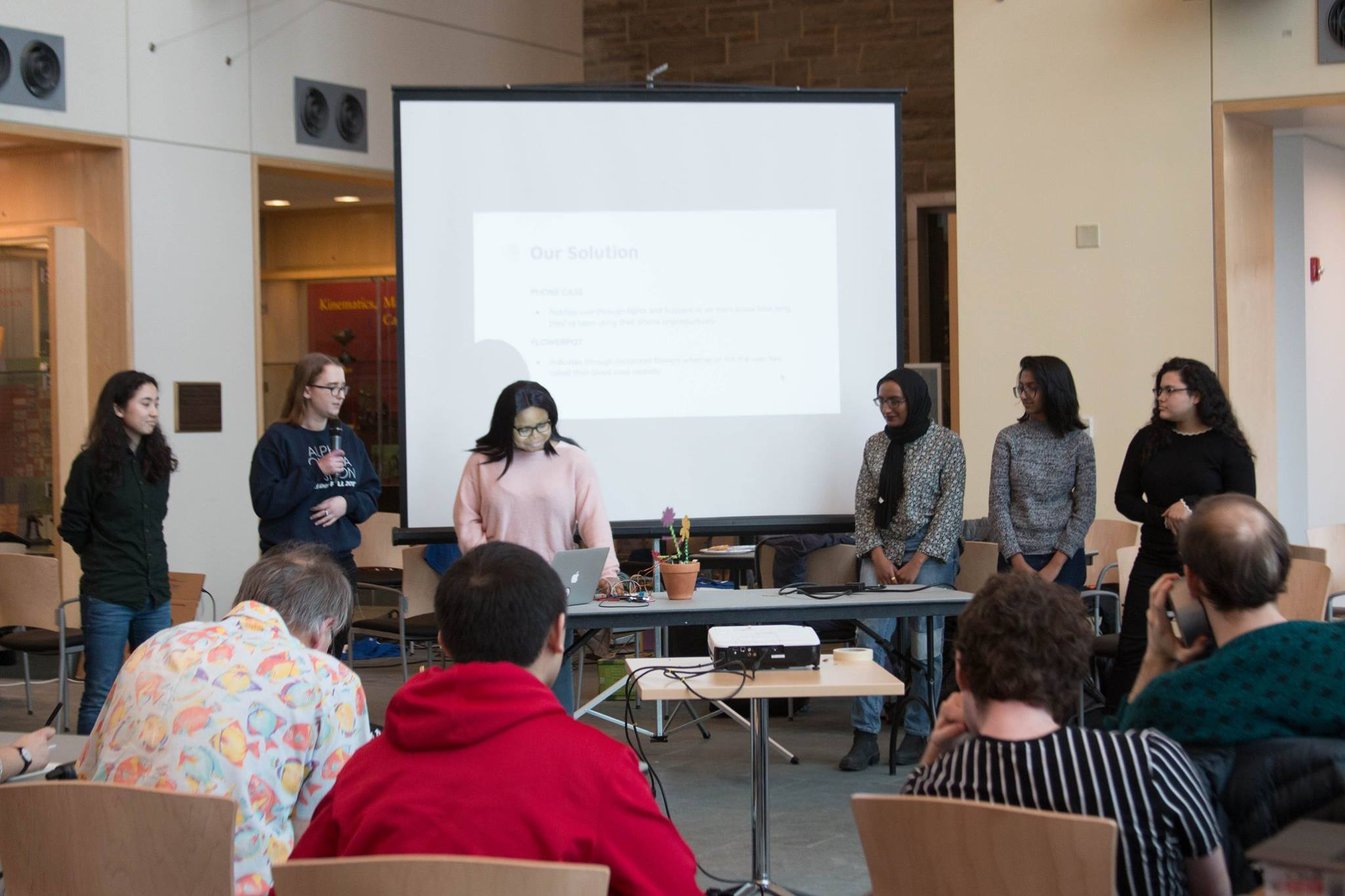 Our team (Team Fruit Snax <3) presenting in.bloom to the hackathon judges!