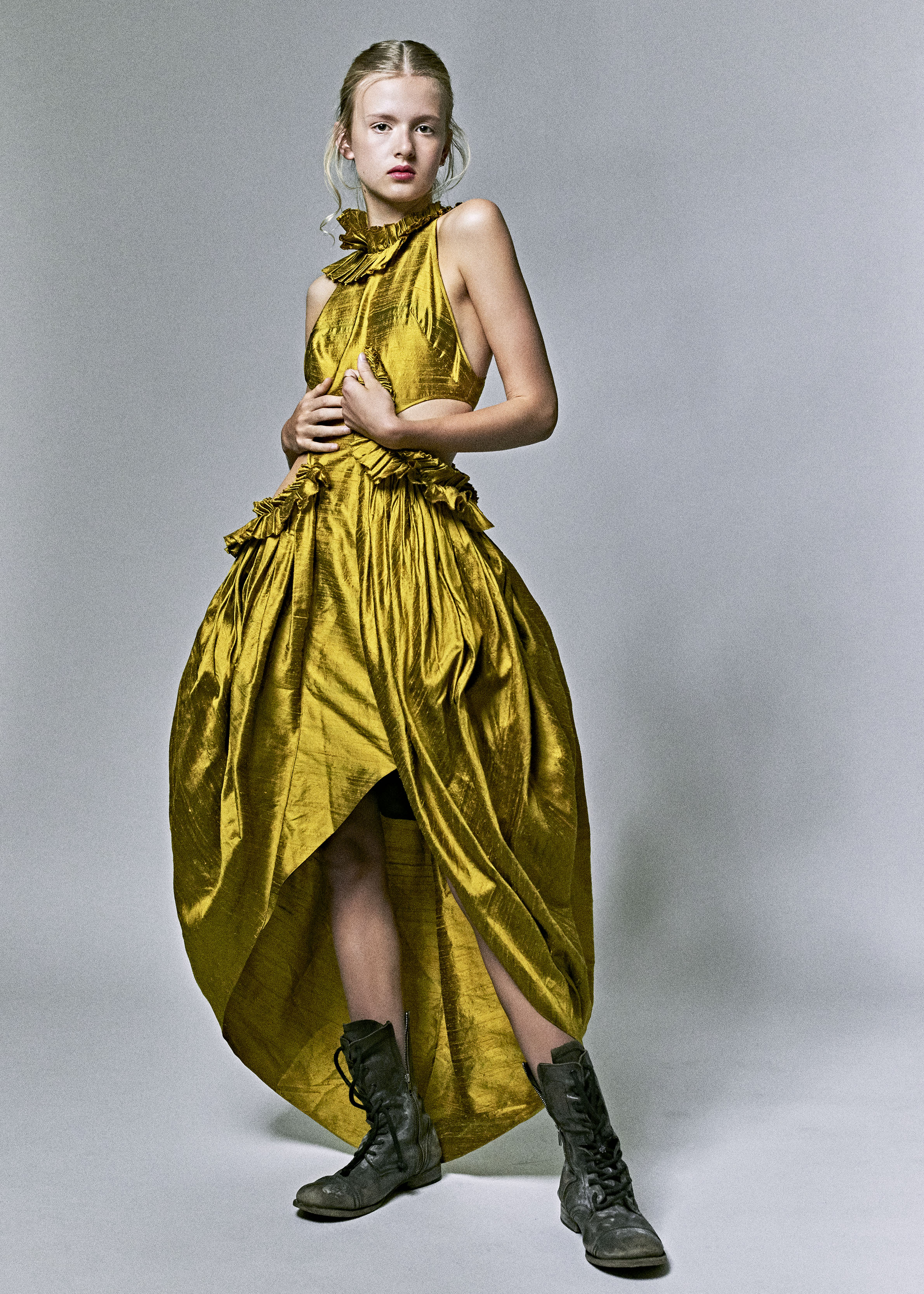 Copy of kelsey randall model gold yellow citrine raw silk shantung asymmetrical ruffle sleeve side cut out gathered ruffled flounce long gown high-low hem tulip high neck dress black leather combat boots