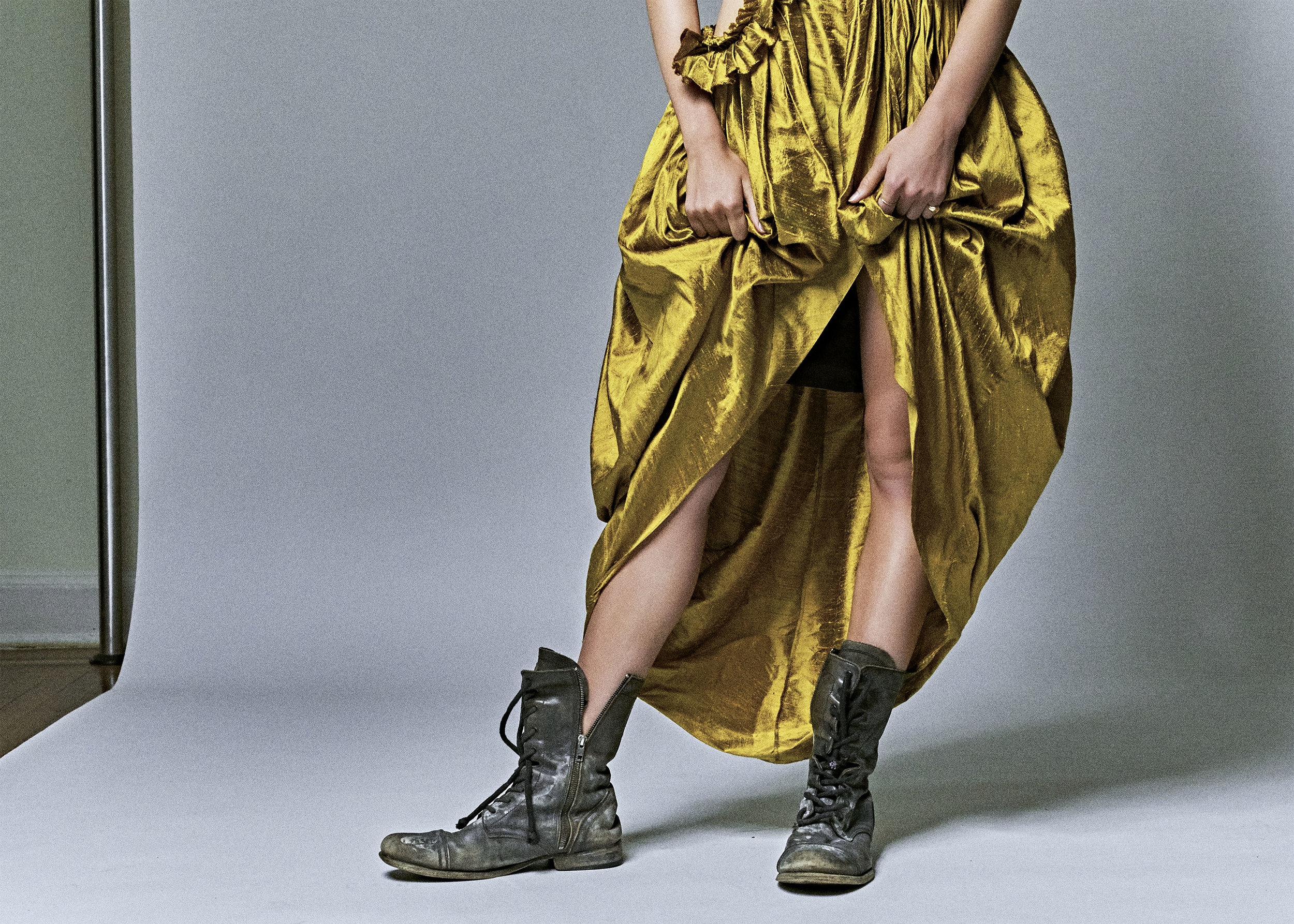 kelsey randall model gold yellow citrine raw silk shantung asymmetrical ruffle sleeve side cut out gathered ruffled flounce long gown high-low hem tulip high neck dress black leather combat boots
