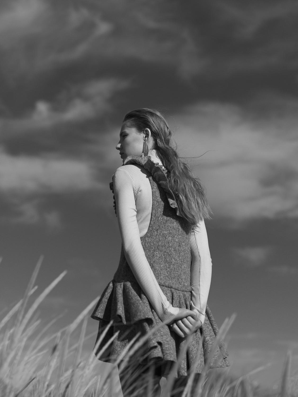 Copy of Wonderland Magazine fashion editorial featuring Kelsey Randall grey boiled felt felted wool jumper dress circle skirt flounce tiered