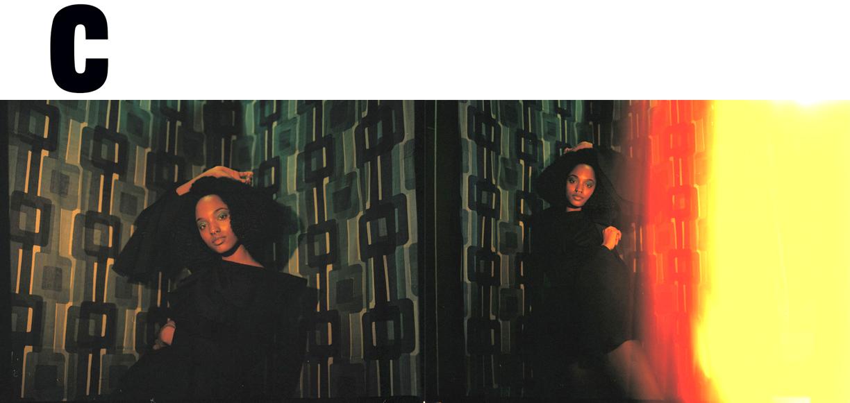 Coeval Magazine Fashion editorial 70's style retro wallpaper film photography  MARYAM NASSIR ZADEH  art deco photography  JHEYDA MCGARRELL  styling  RACHAEL WANG  hair  ANDRITA RENEE  make up  BAILEY PRADO  photography assistant  NICOLE RETALIS  set design  MEL WALBRIDGE   Kelsey Randall navy faux suede skater dress flounce sleeve diversity made-to-measure luxury womenswear made in New York City Brooklyn NYC custom handcrafted bespoke