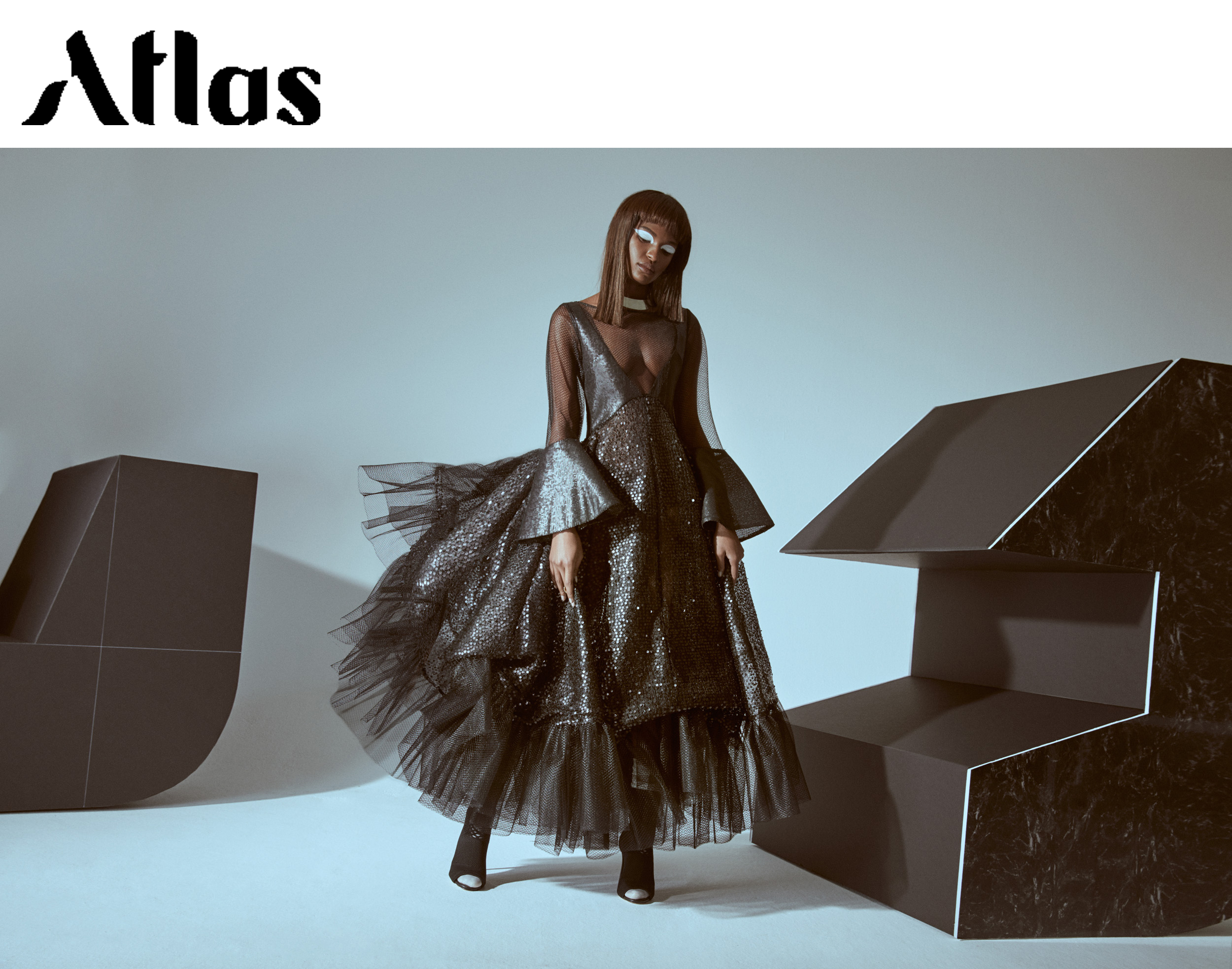 Atlas Magazine fashion editorial feature Kelsey Randall luxury womenswear bespoke made-to-measure New York City made in NYC black tulle sequin bustle gown bell sleeve ruffle deep v baby blue aqua Bailey Robb Cecilia Elguero Kate Ryan Marcos Campos Katie James