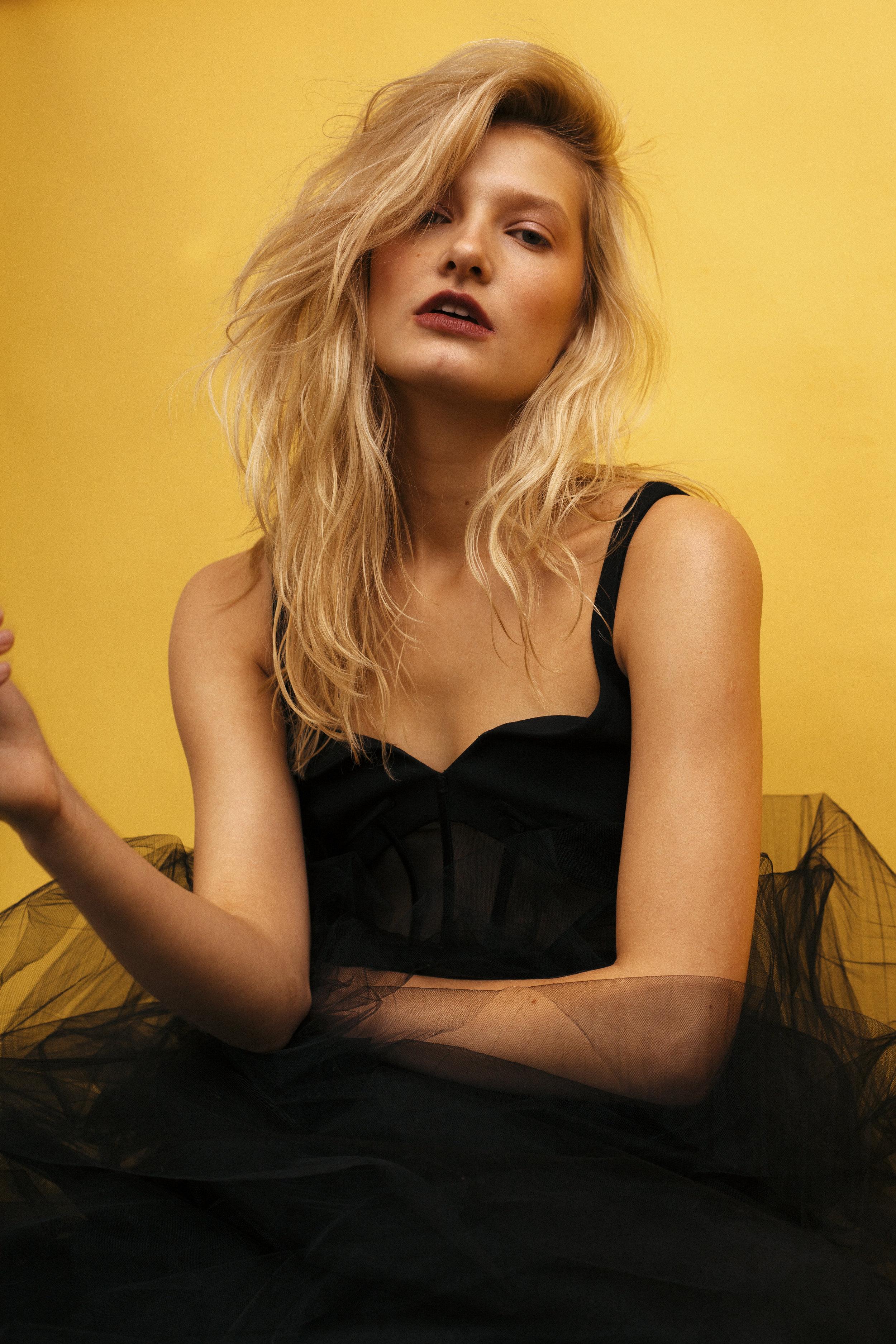 Heather Newberger shoots Kelsey Randall black silk faille bra top gold hook back