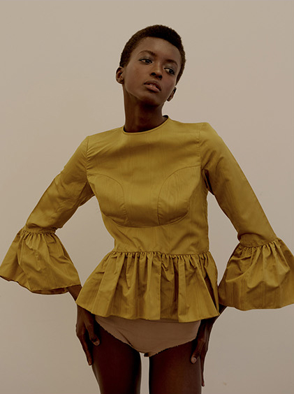 Kelsey Randall Stories Collective fashion editorial featuring gold marigold silk moire bell sleeve 3/4 length blouse ruffle hem exposed zipper back