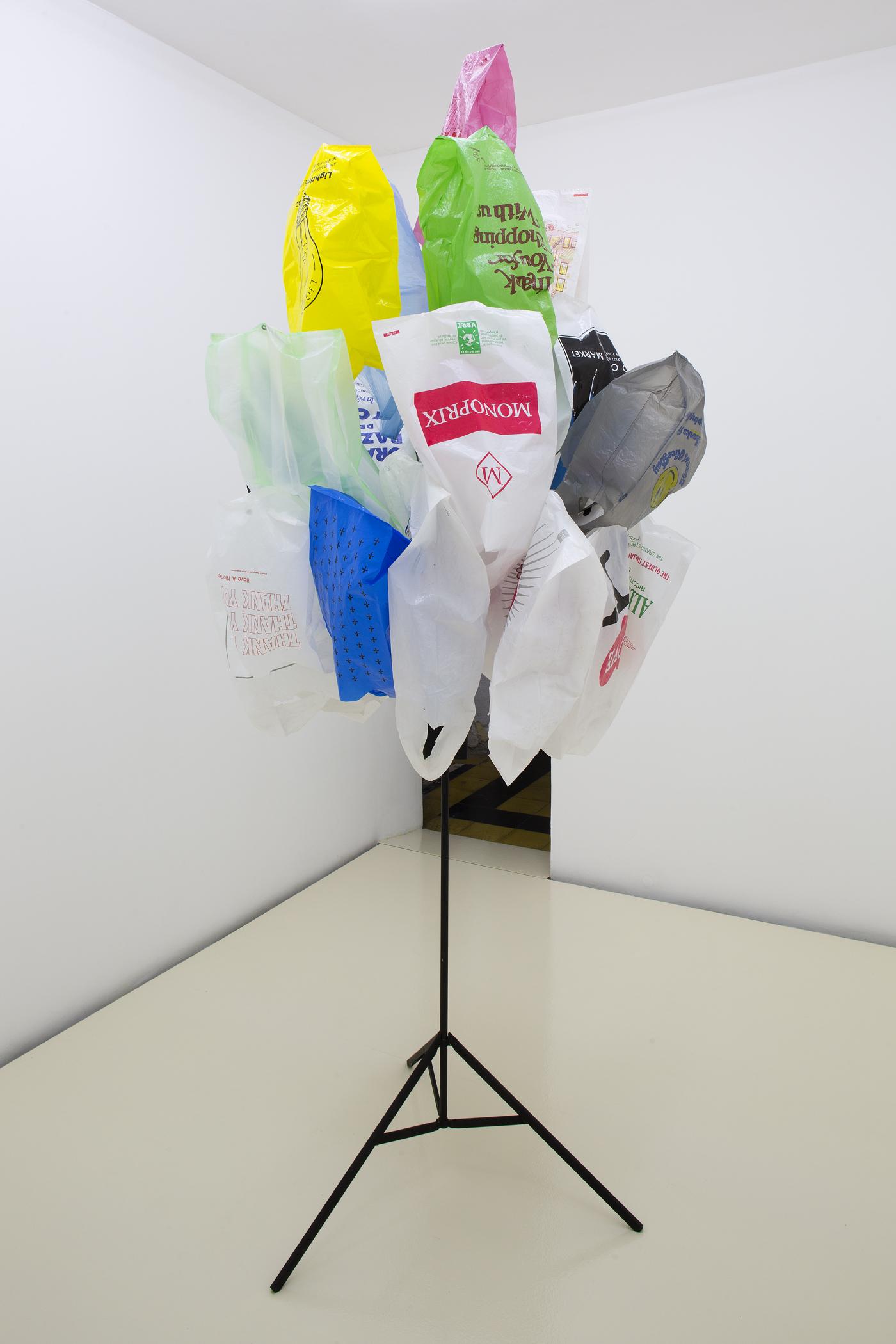 Bunch #4, 1996, Metal, wood, wire, enamel paint, plastic bags, ca. 250 cm high