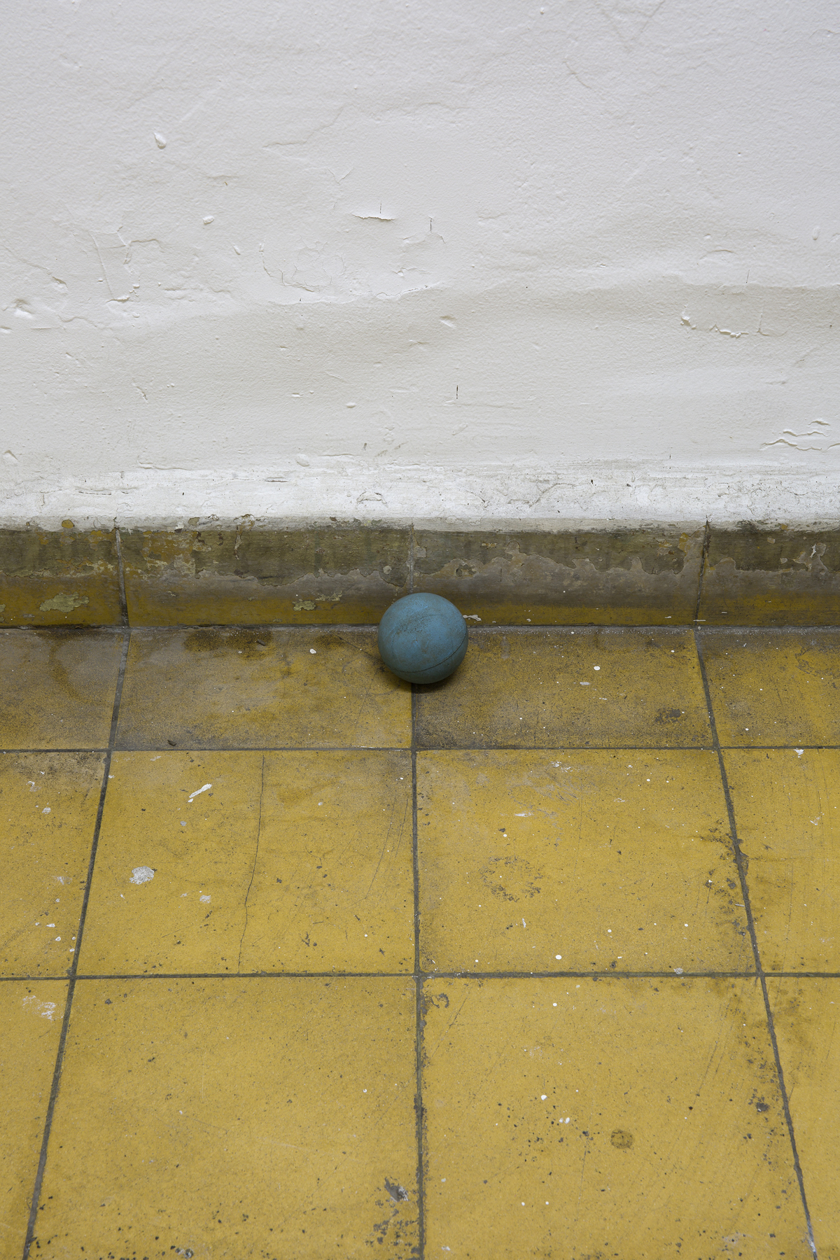 Ball, 2017. Installation with muddy ball against wall (Unique), dimensions variable. (Detail)