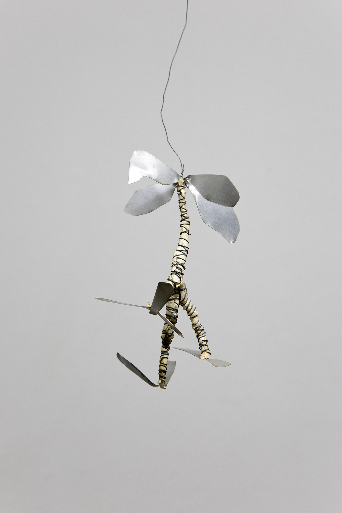 Miho Dohi, Hanged Creatures, 2004.  Aluminum, wire, paper, h16 x w11 x d7 cm
