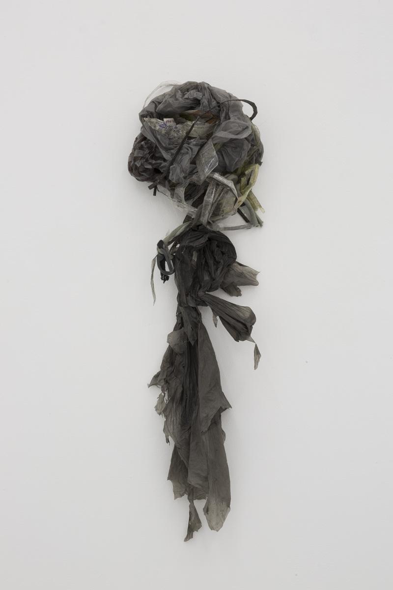 Yuji Agematsu,  2019.04.01 - PM 3:21. La Merced, San Miguel and Jon Hormiguero  2019. Plastic, cloth, paper, adhesive tape. 25 x 6 3⁄4 in (63.5 x 17 cm)