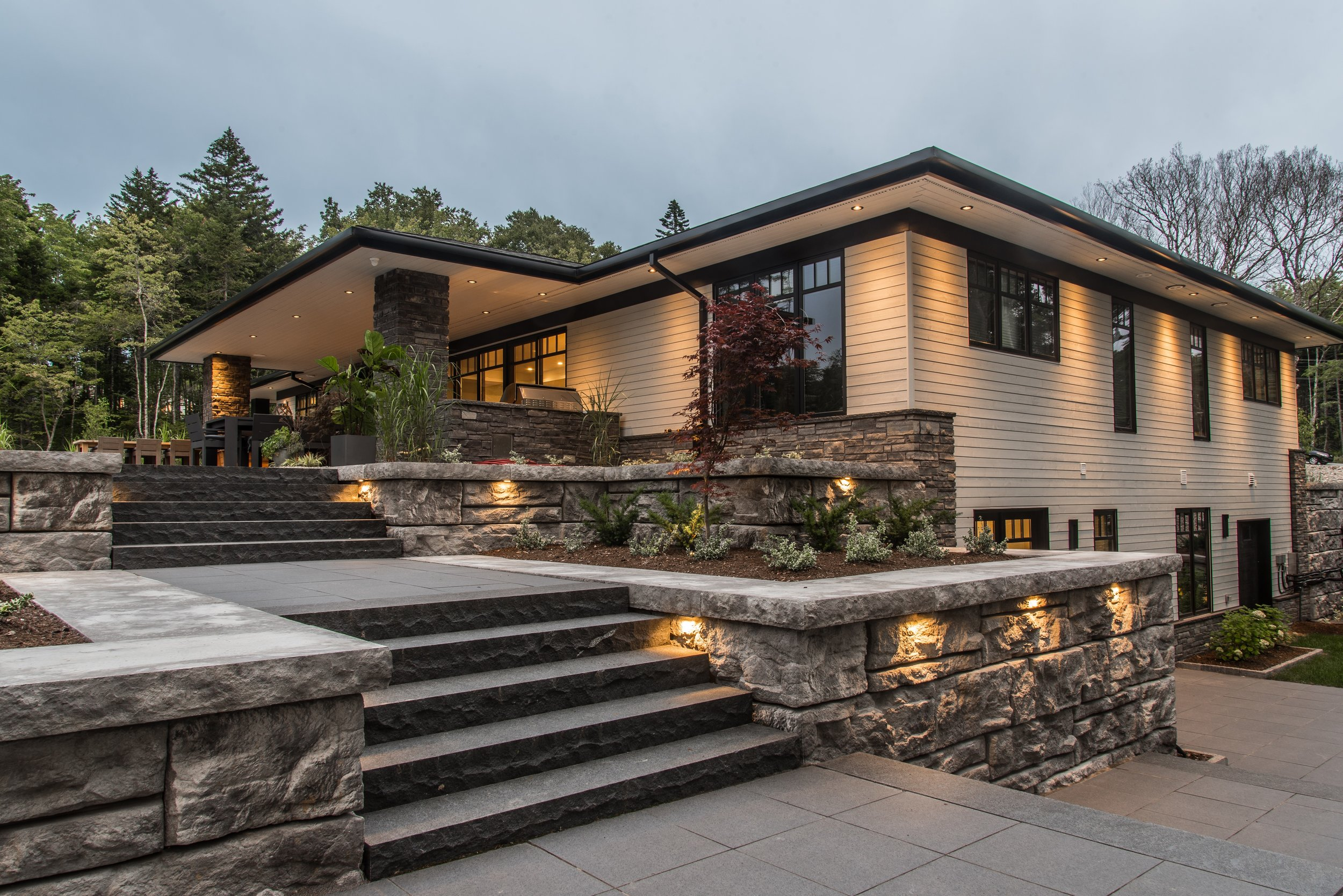Executive Modern Build - This style is a blend of mid-century modern and the latest trends leaning towards sleek, contemporary design. This Home is characterized by clean, simple lines, a low-pitched gable roof, large black contemporary windows and a beautiful open floor plan.