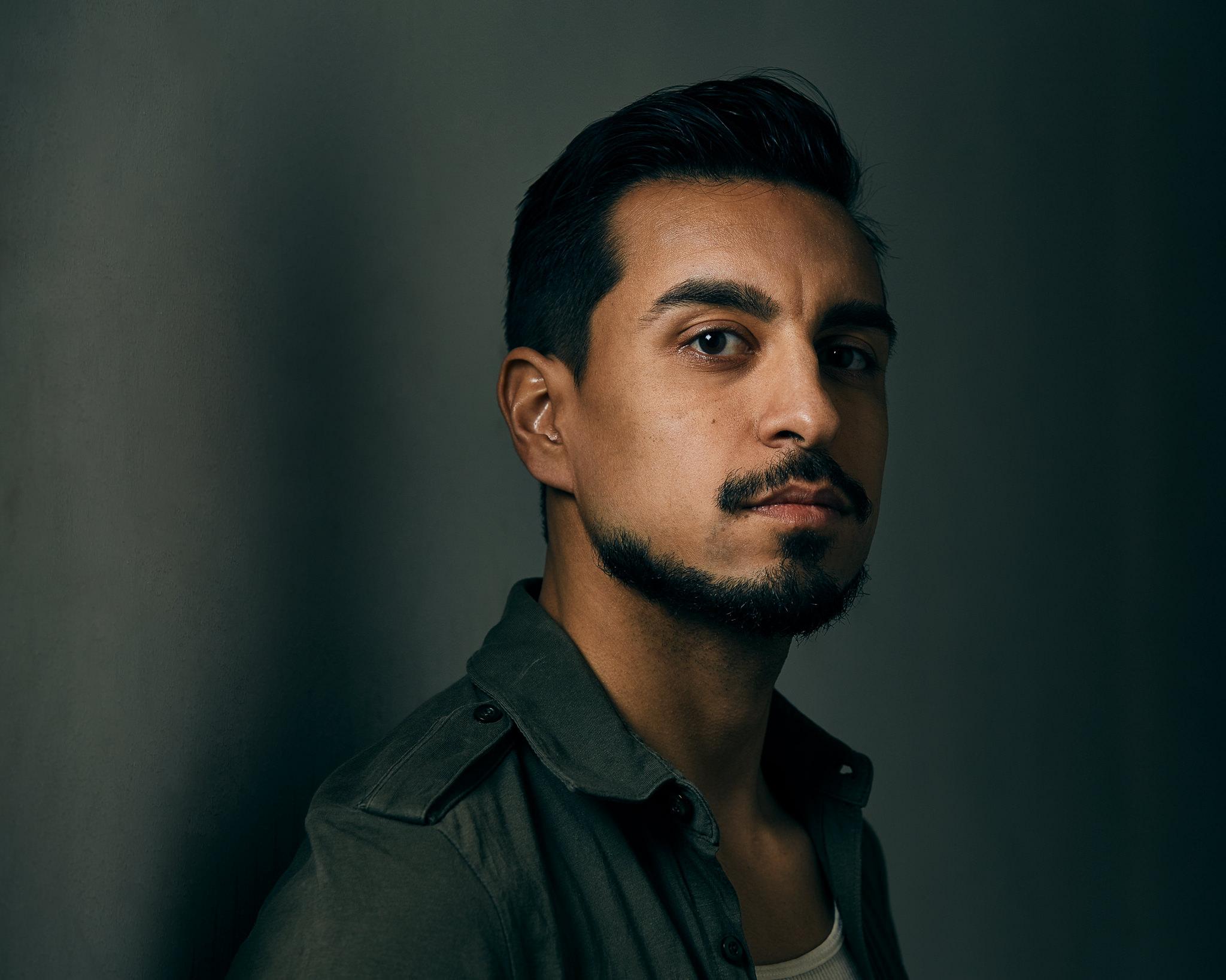 Professional headshot of male actor in studio.