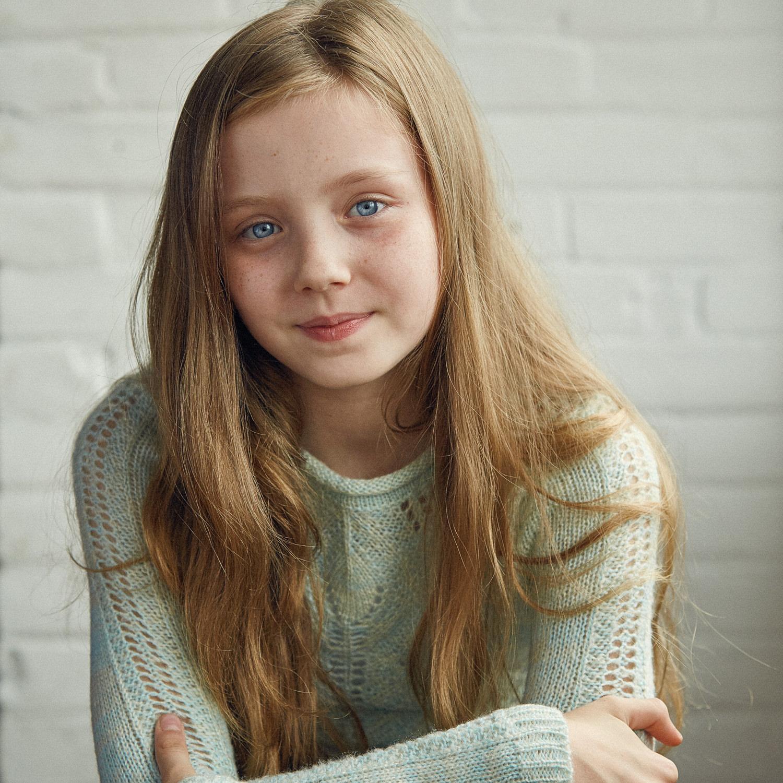 Young child actor headshot in studio.