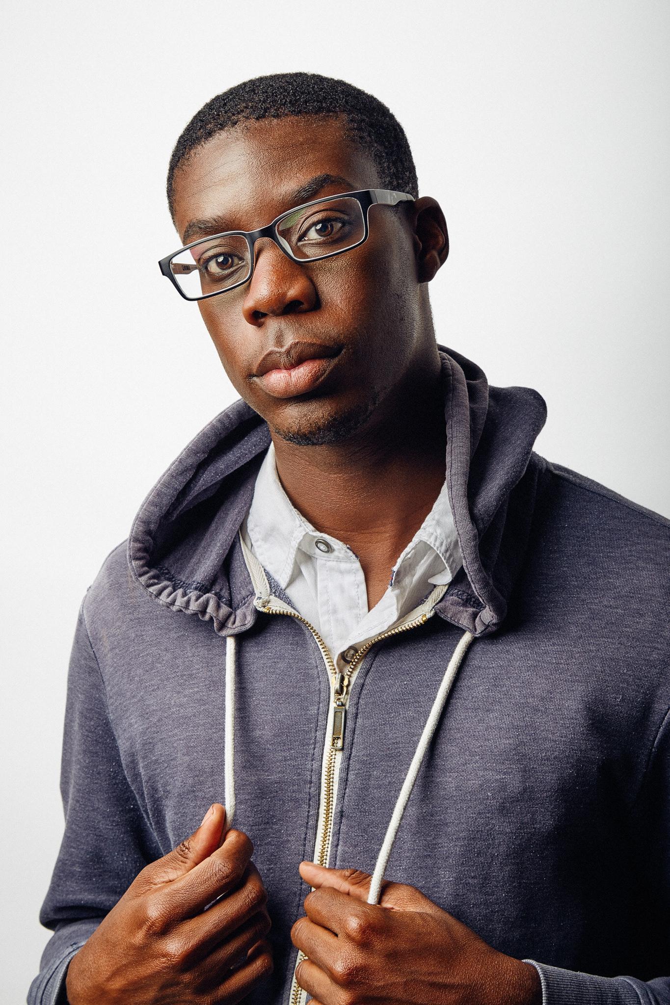 Adult male actor professional headshot on white background.
