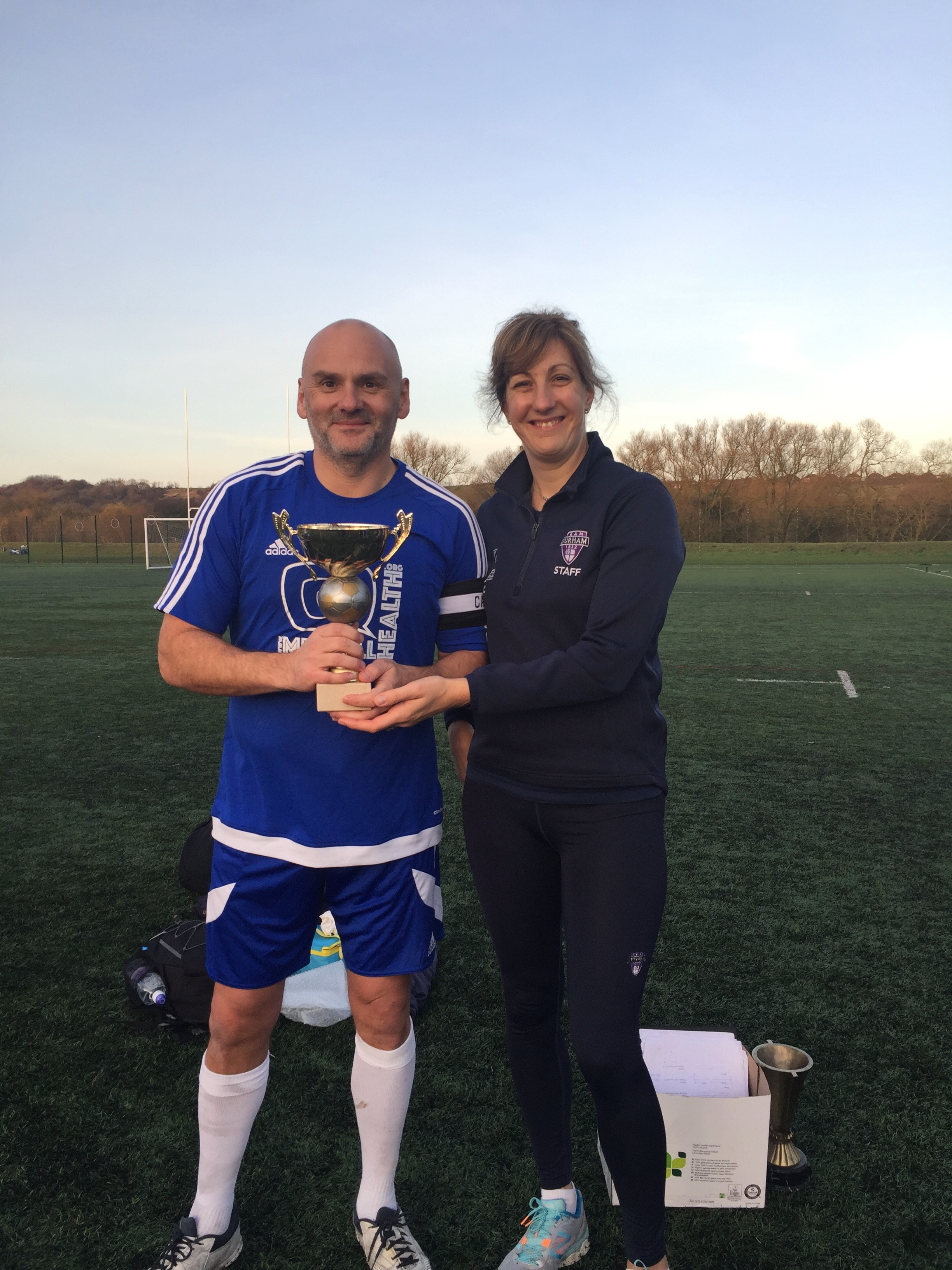 Captain Rich with the prize (the trophy, not the lady).