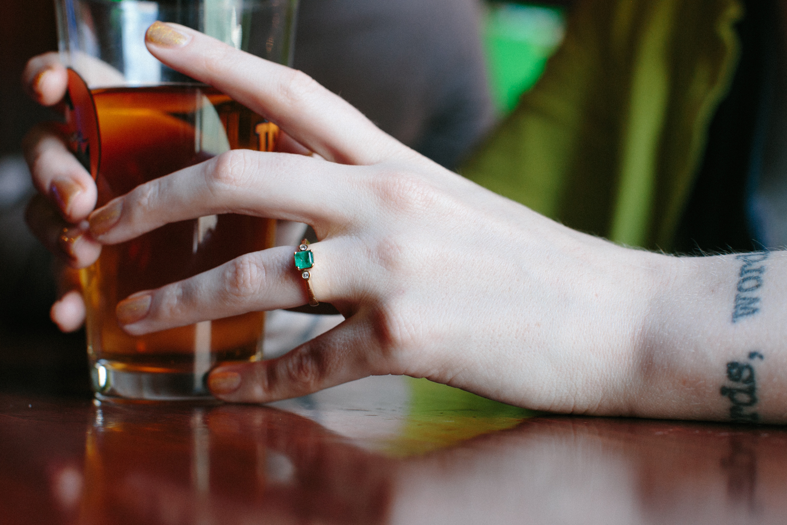 engagement photos in a bar
