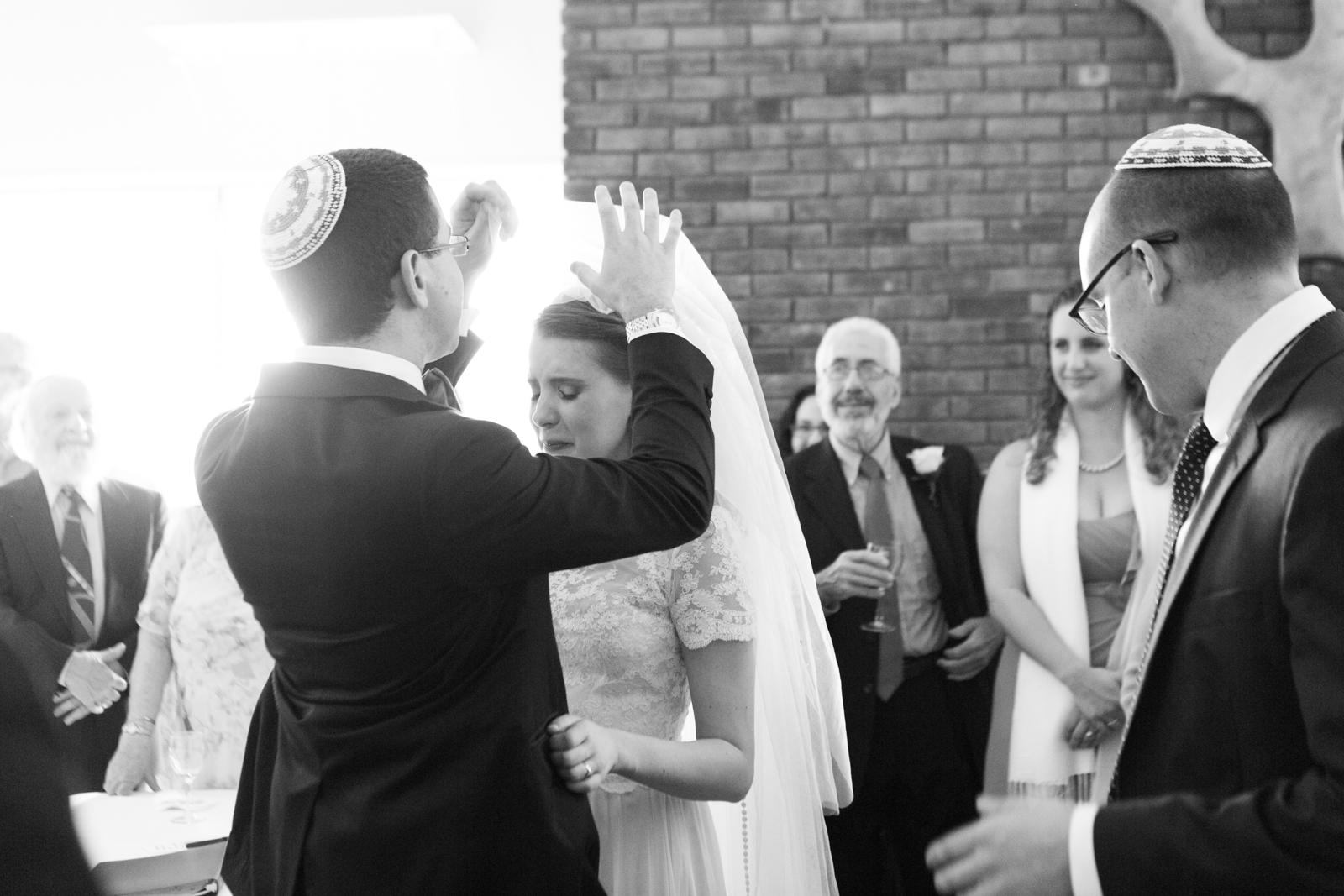 groom lifting veil