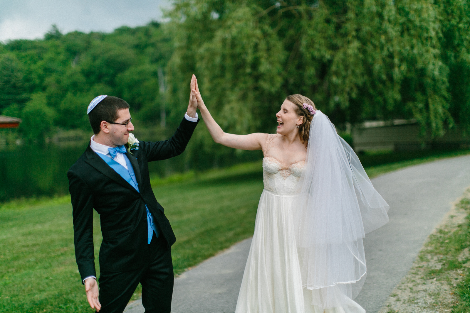 newlyweds high-fiving