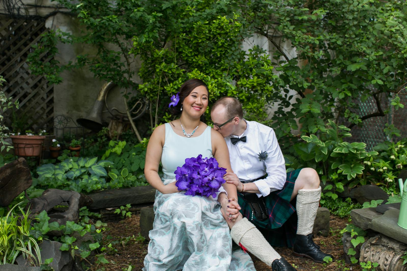 groom kissing bridal shoulder