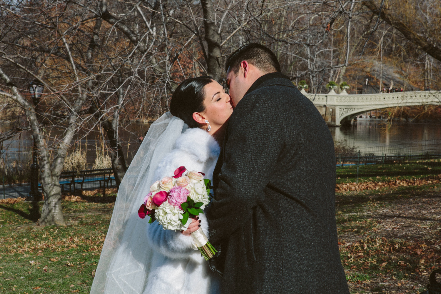 Bride and groom share a kiss on their wedding day
