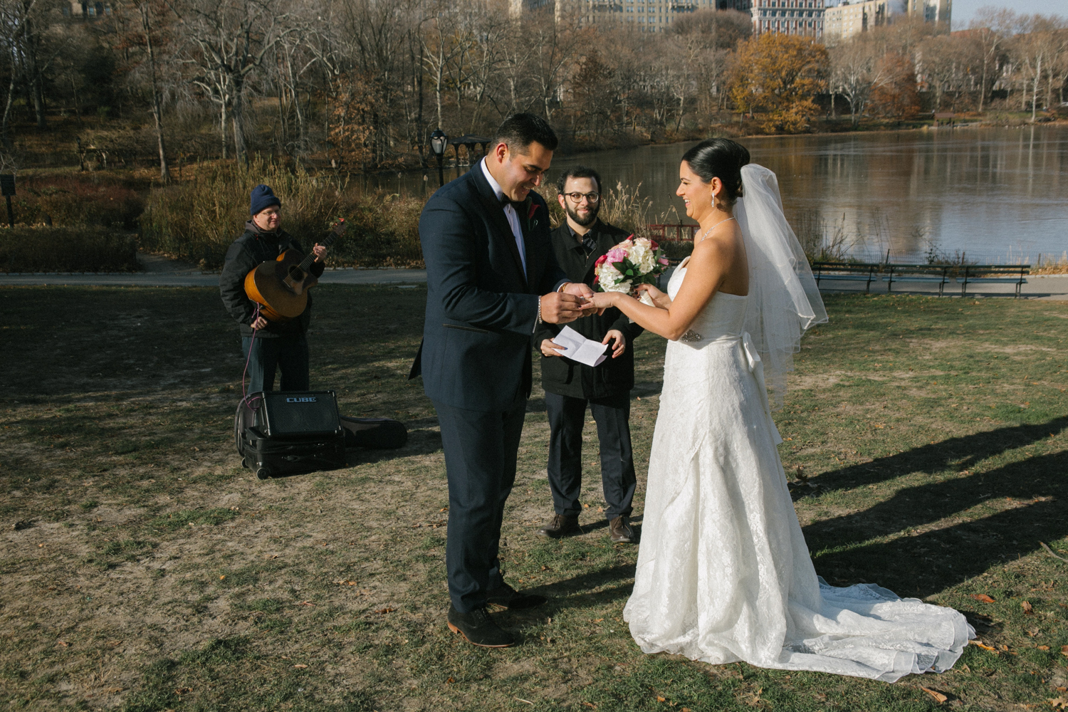 Bride an groom exchange rings during their elopement ceremony