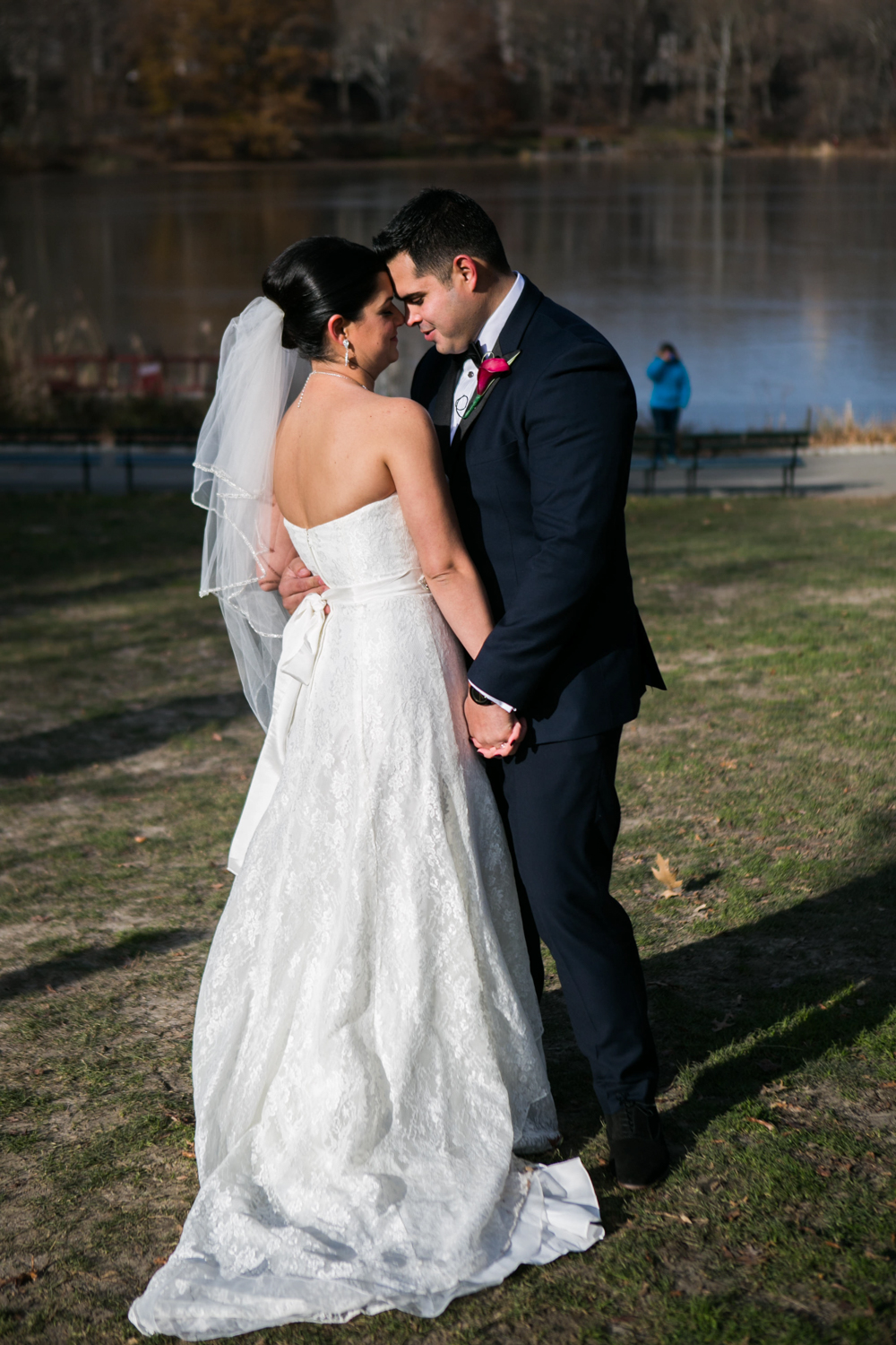 Bride and groom embrace in Central Park