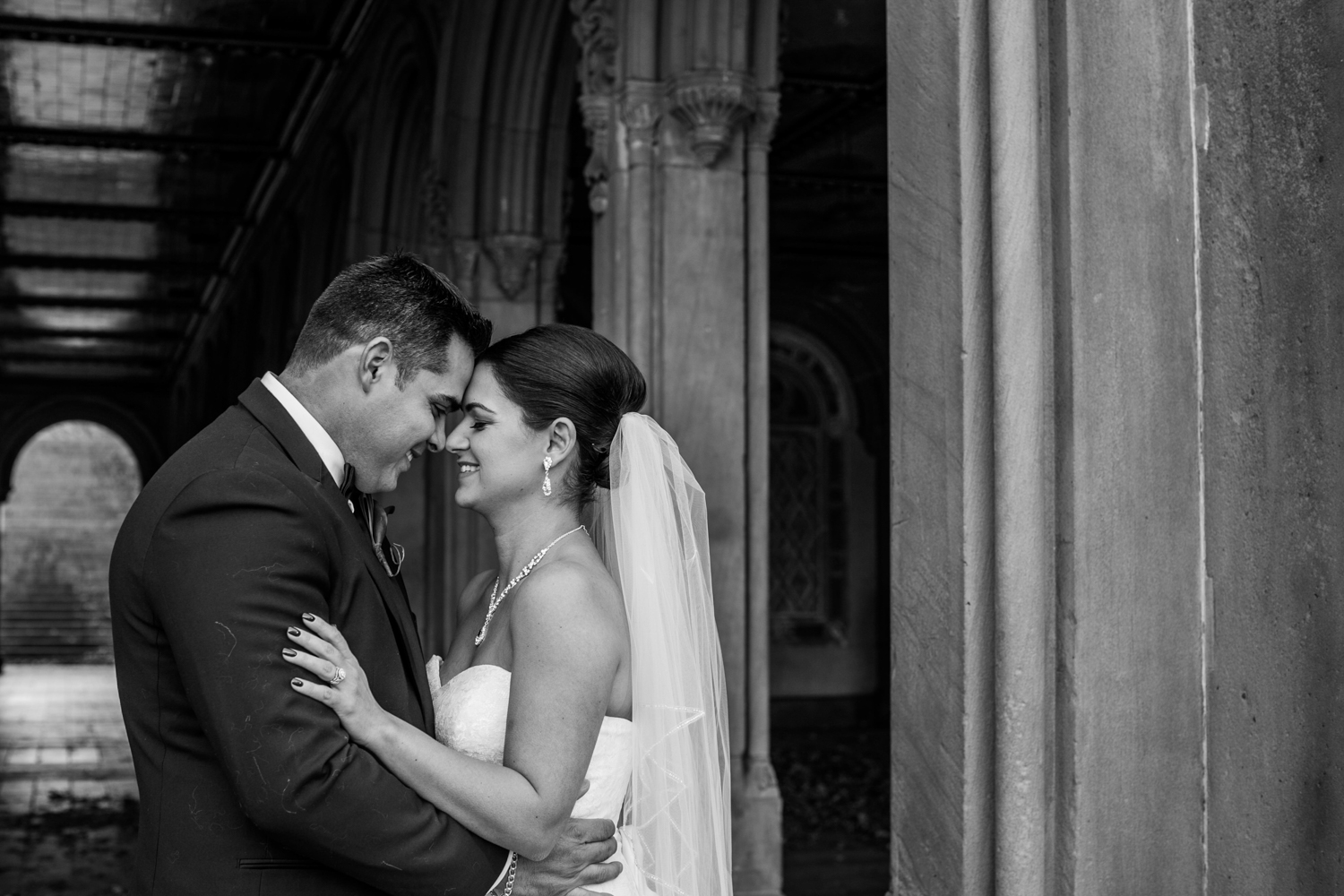 Black and white photo of groom holding his bride
