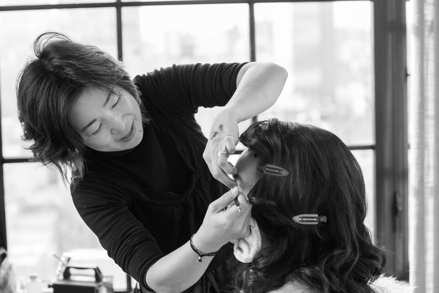 Bride getting make up done by Sachiko Yanase