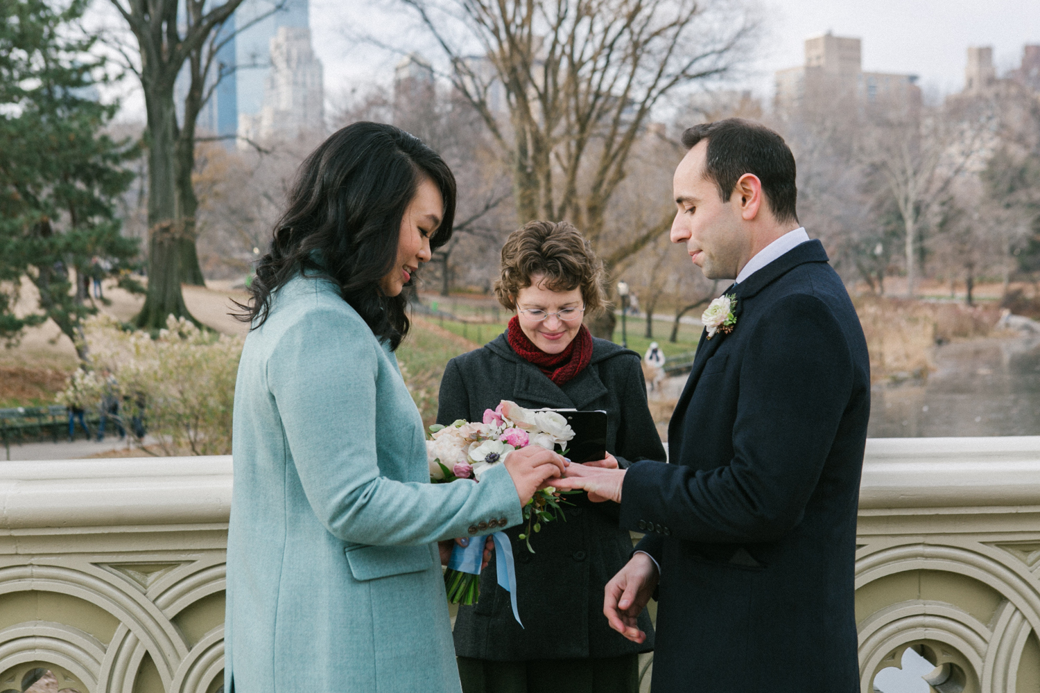 NYC bride and groom exchange rings during elopement