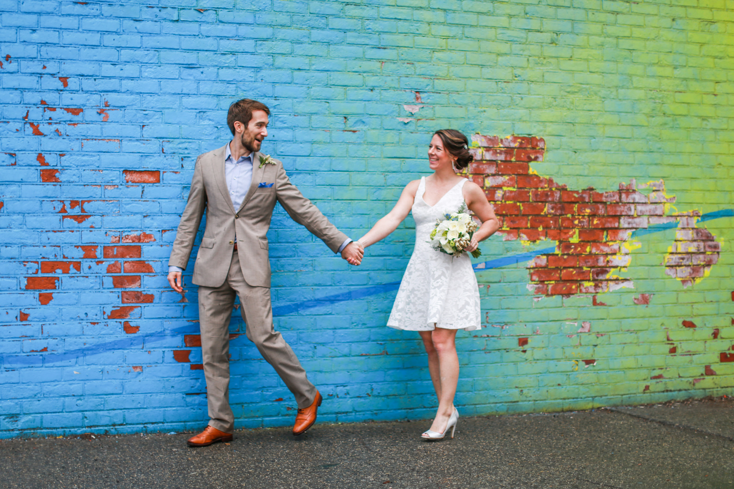 Bride and groom with NYC wall art