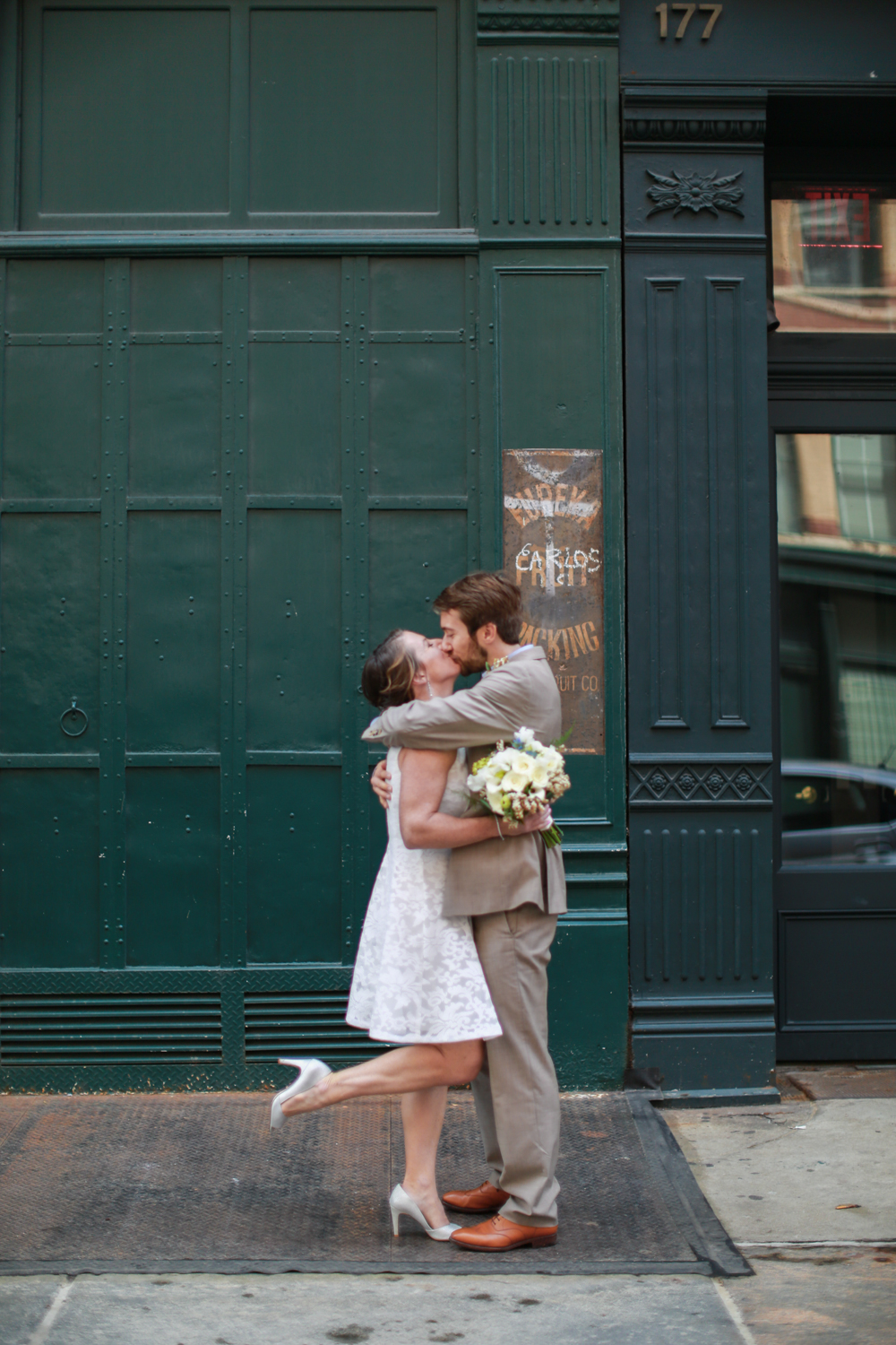 Bride and groom kiss after NYC elopement