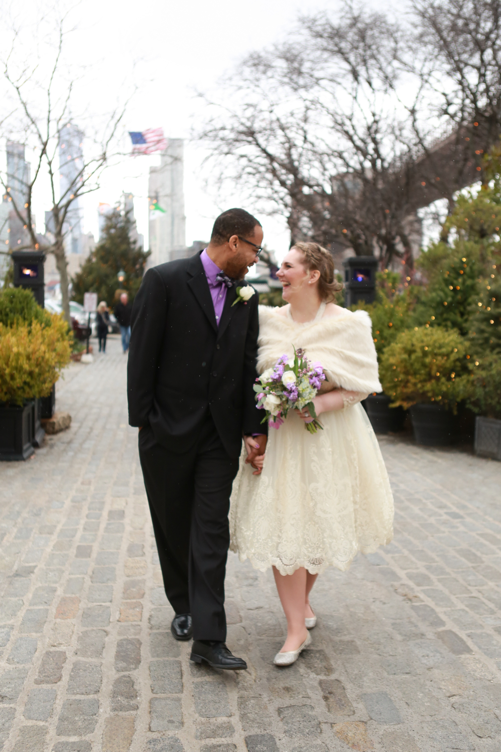 Bride and groom walking through NYC