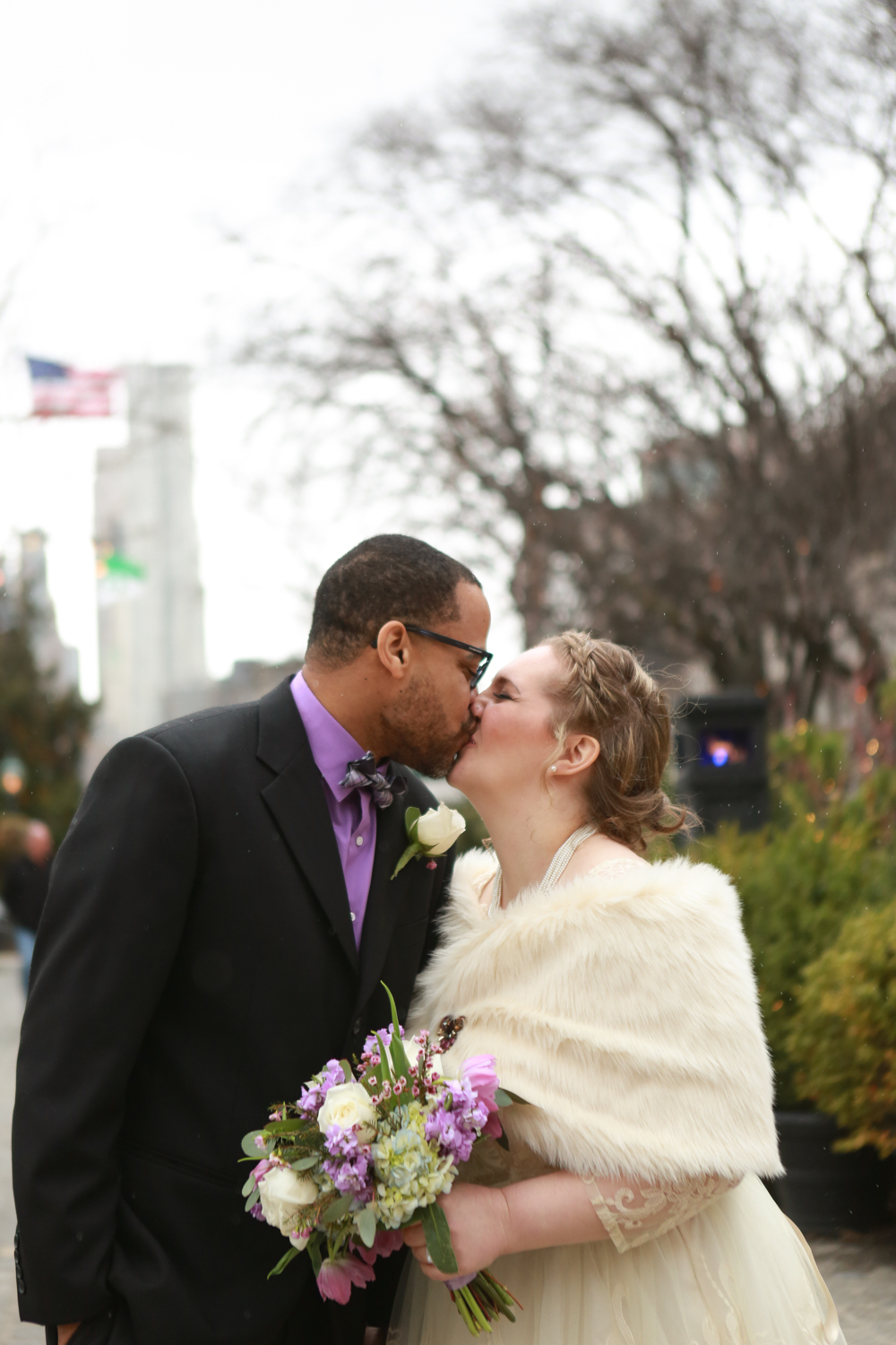 Photograph of bride and groom kissing in NYC