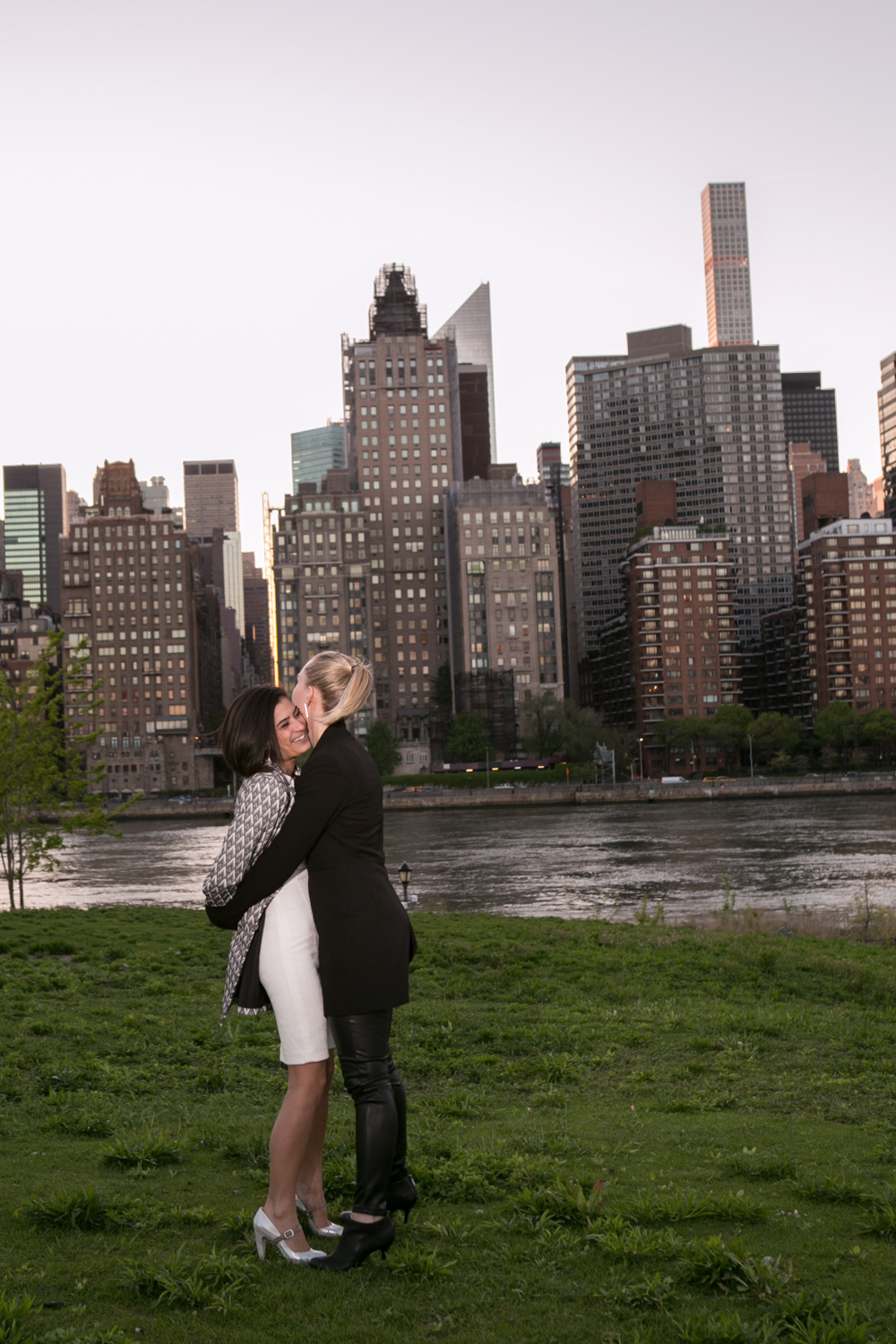 Engaged Couple hugs in New York City