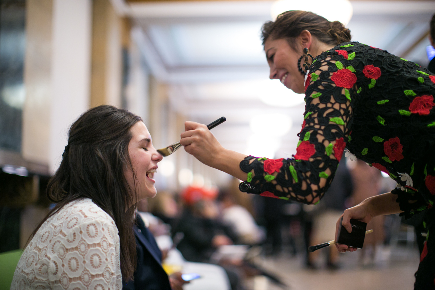 bride getting makeup done in NYC