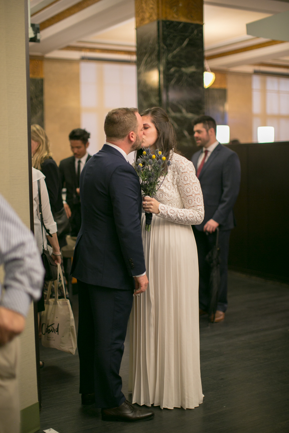 Groom kisses his bride on elopement day