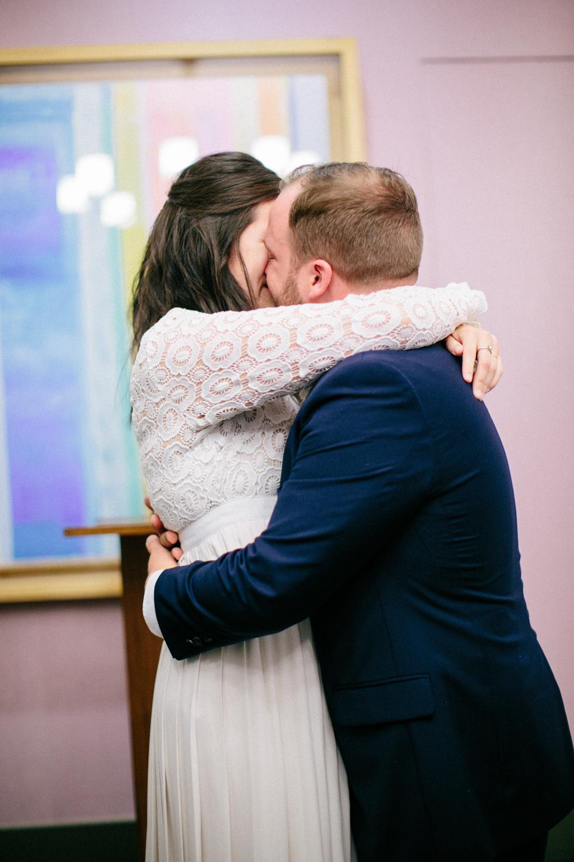 New York City bride and groom hug