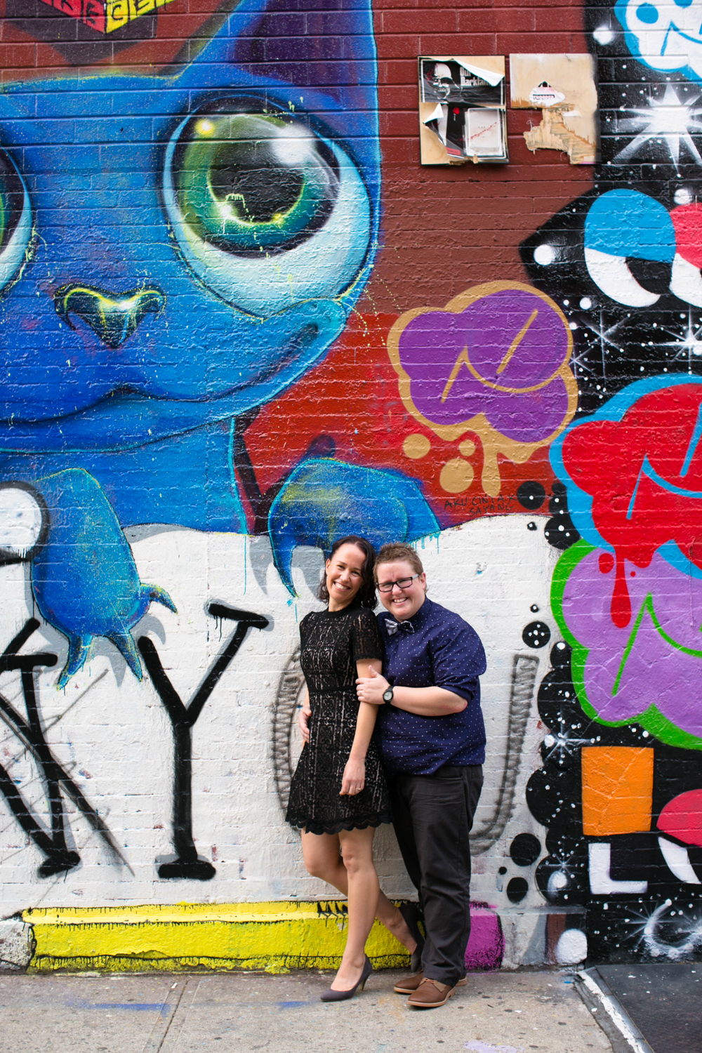 Couple Photography with wall art in New York City