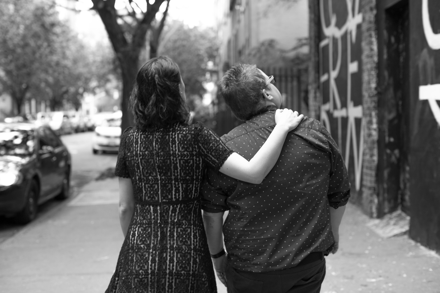 Photograph of couple walking through NYC