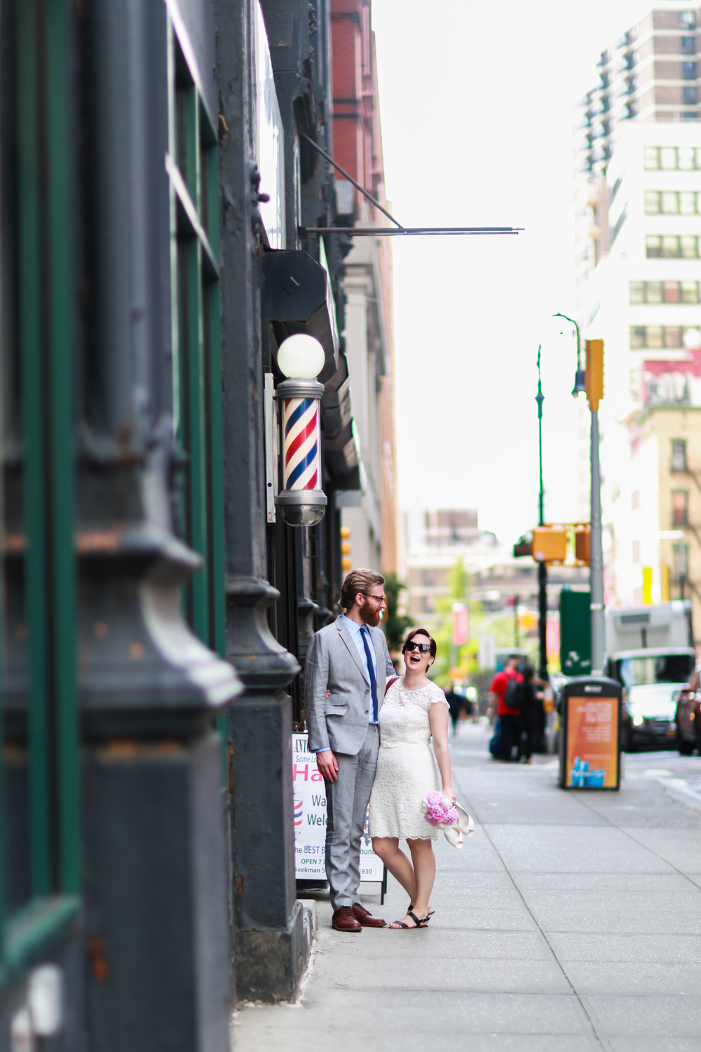 Bride and groom walk the streets of NYC