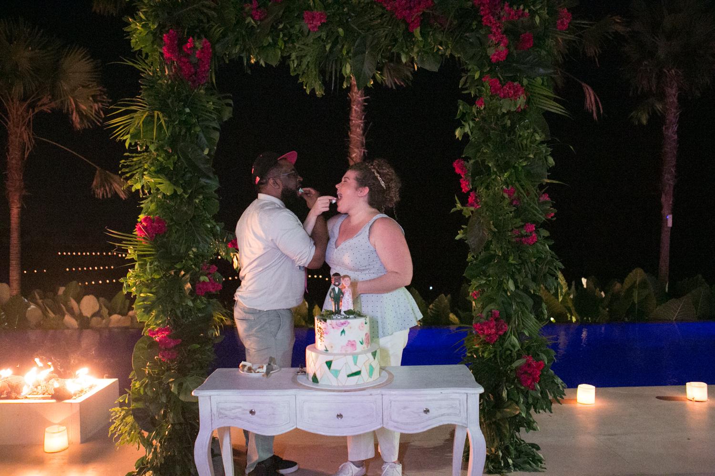 Cutting the cake at Bali wedding reception