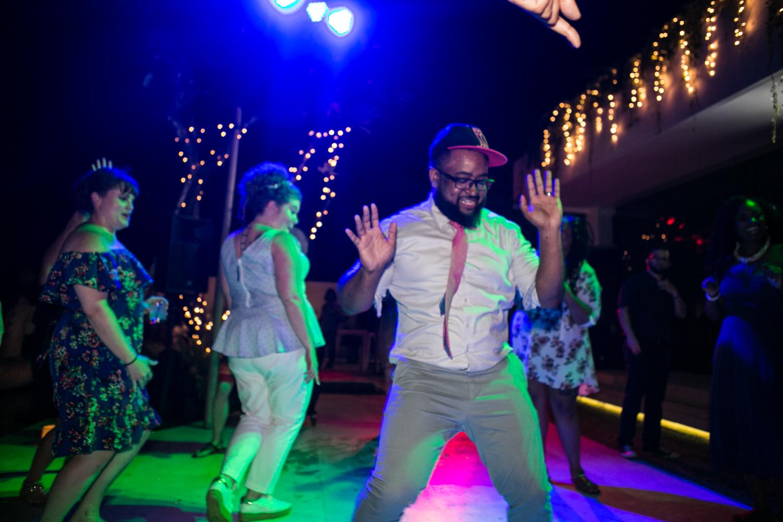 Groom dancing at destination wedding
