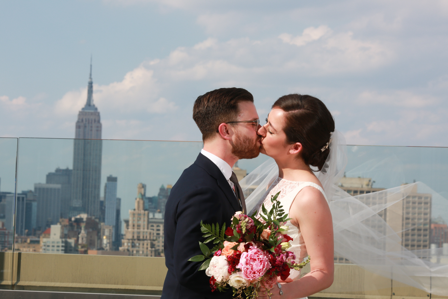 Bride and groom with New York City Skyline