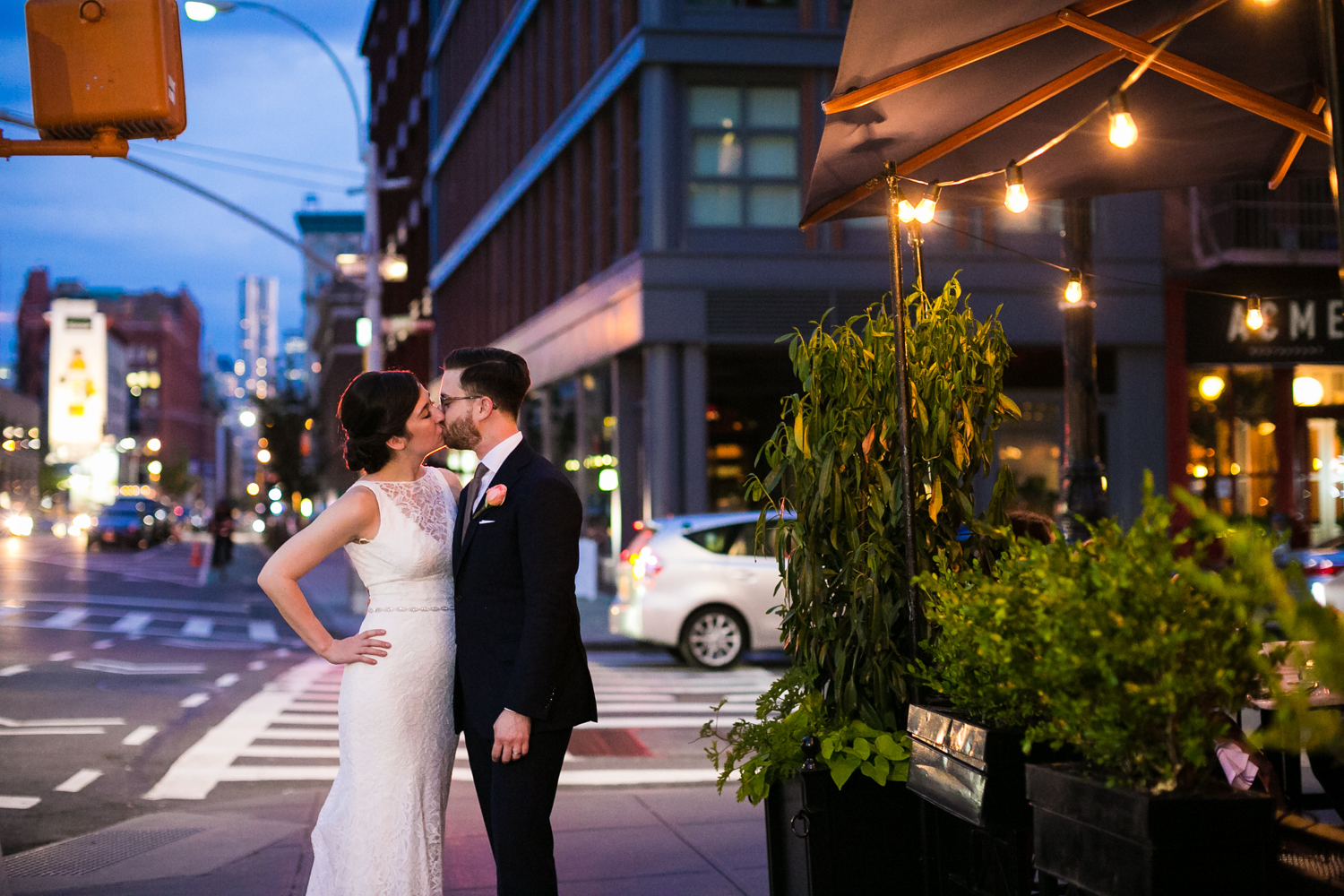 Bride and groom kiss on the streets of NYC