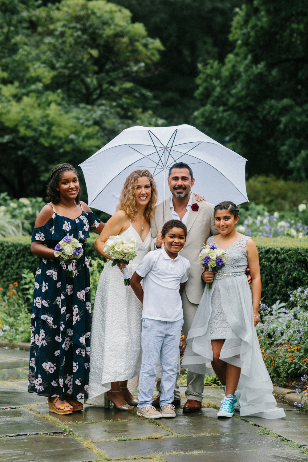 Photograph of NYC bride and groom with family