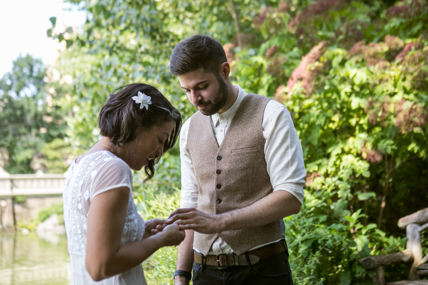 Bride and groom exchange rings in their Central Park elopement.