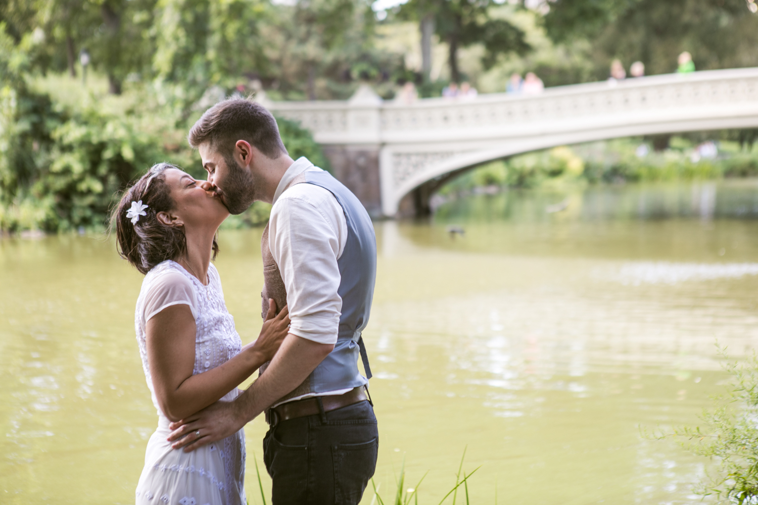 Bride and groom kiss during their wedding ceremony in Central Park.