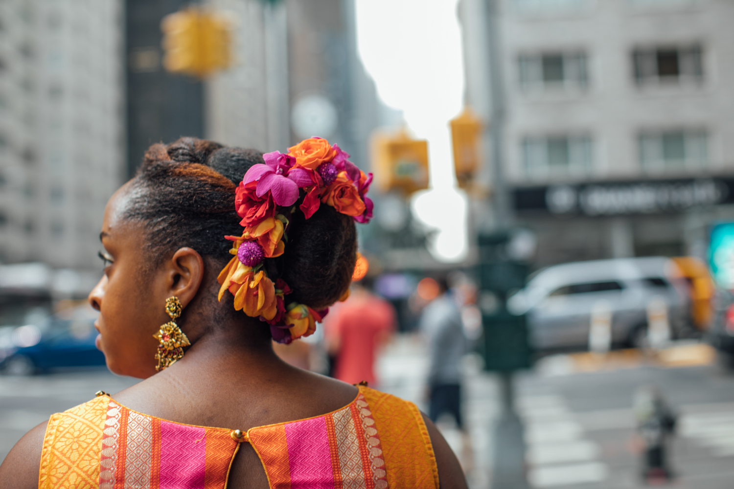 Portrait of the bride with colorful fresh flowers in her hair.